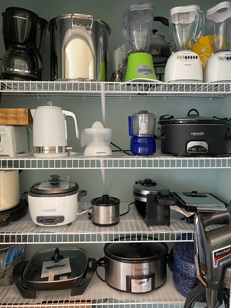 Closet filled with so many small appliances