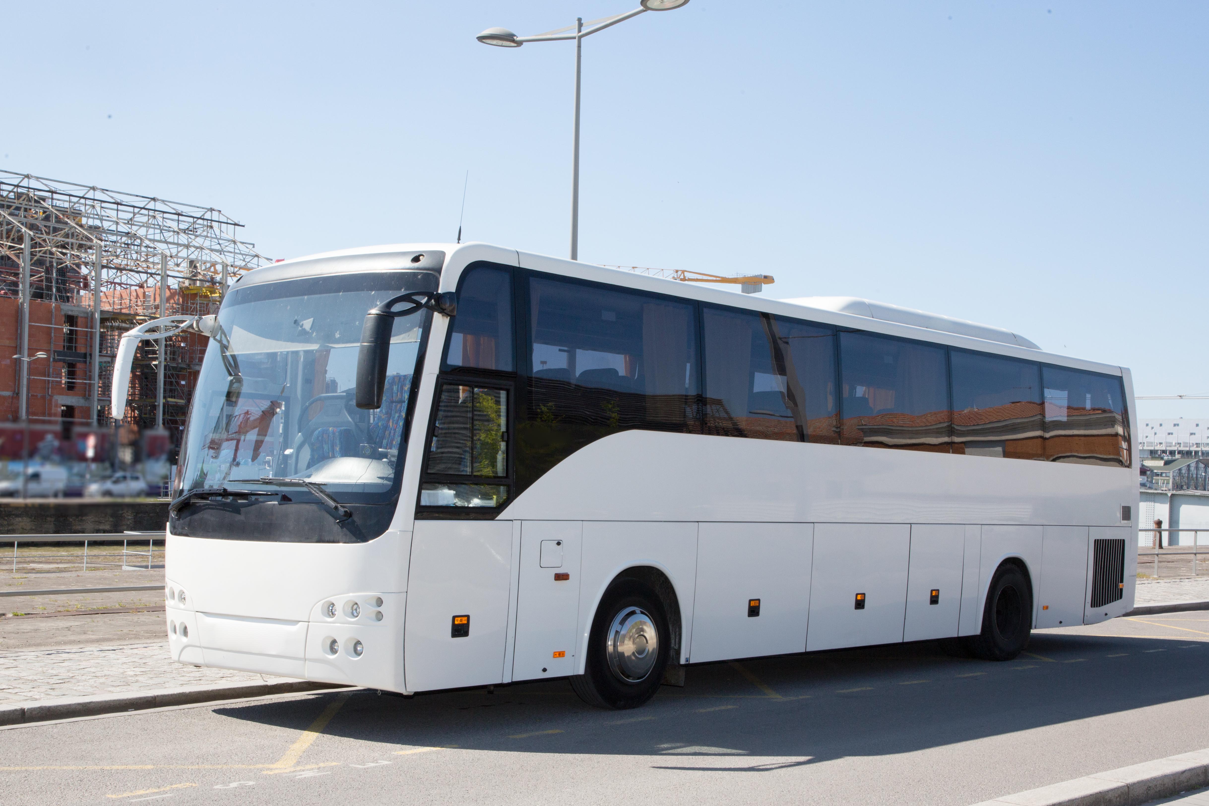 white-bus-modern-park-city