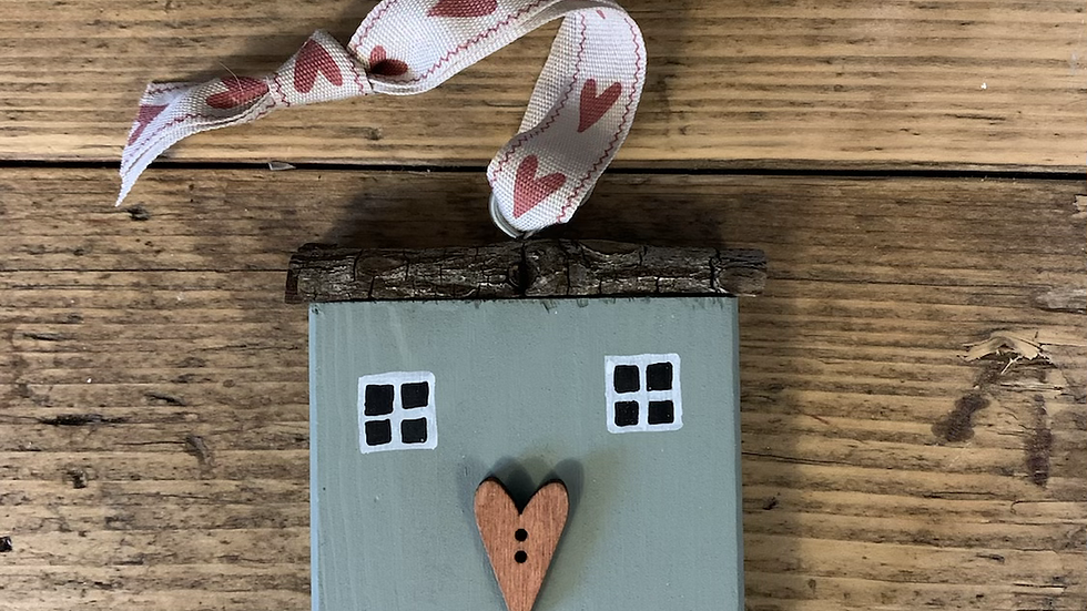 Wooden hanging house in green, heart button