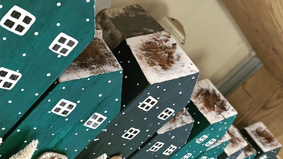 Wooden Christmas snowy house. Tall town house ornament
