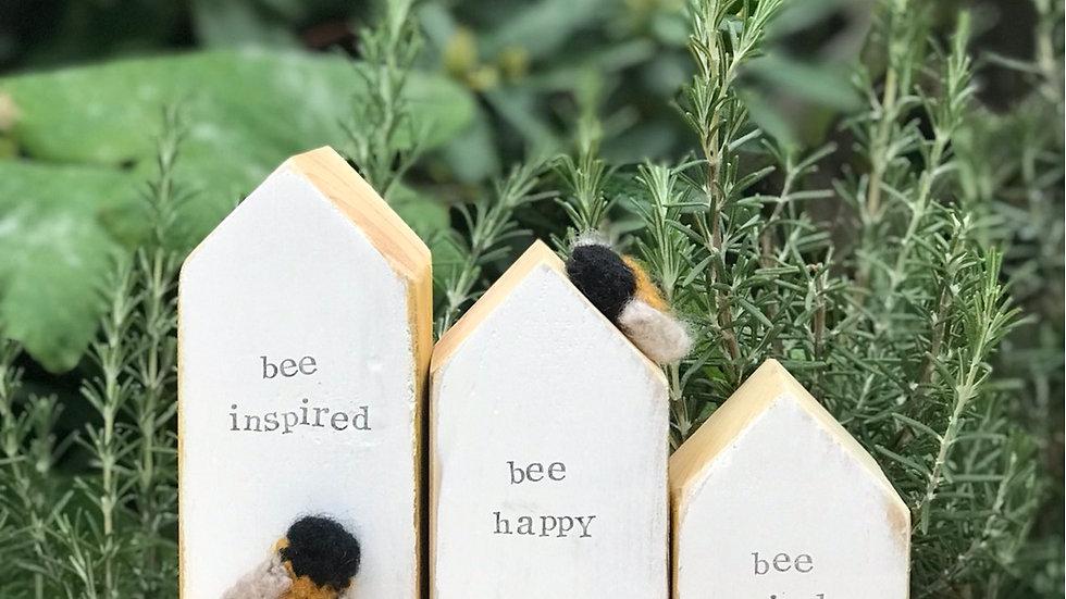 Group of three 'bee kind' houses