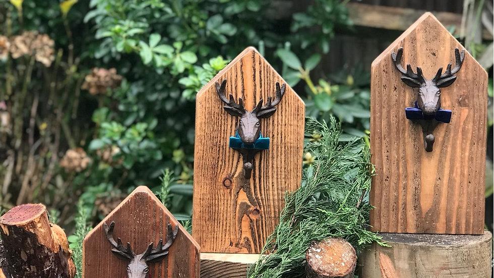 Stag head hook on wood