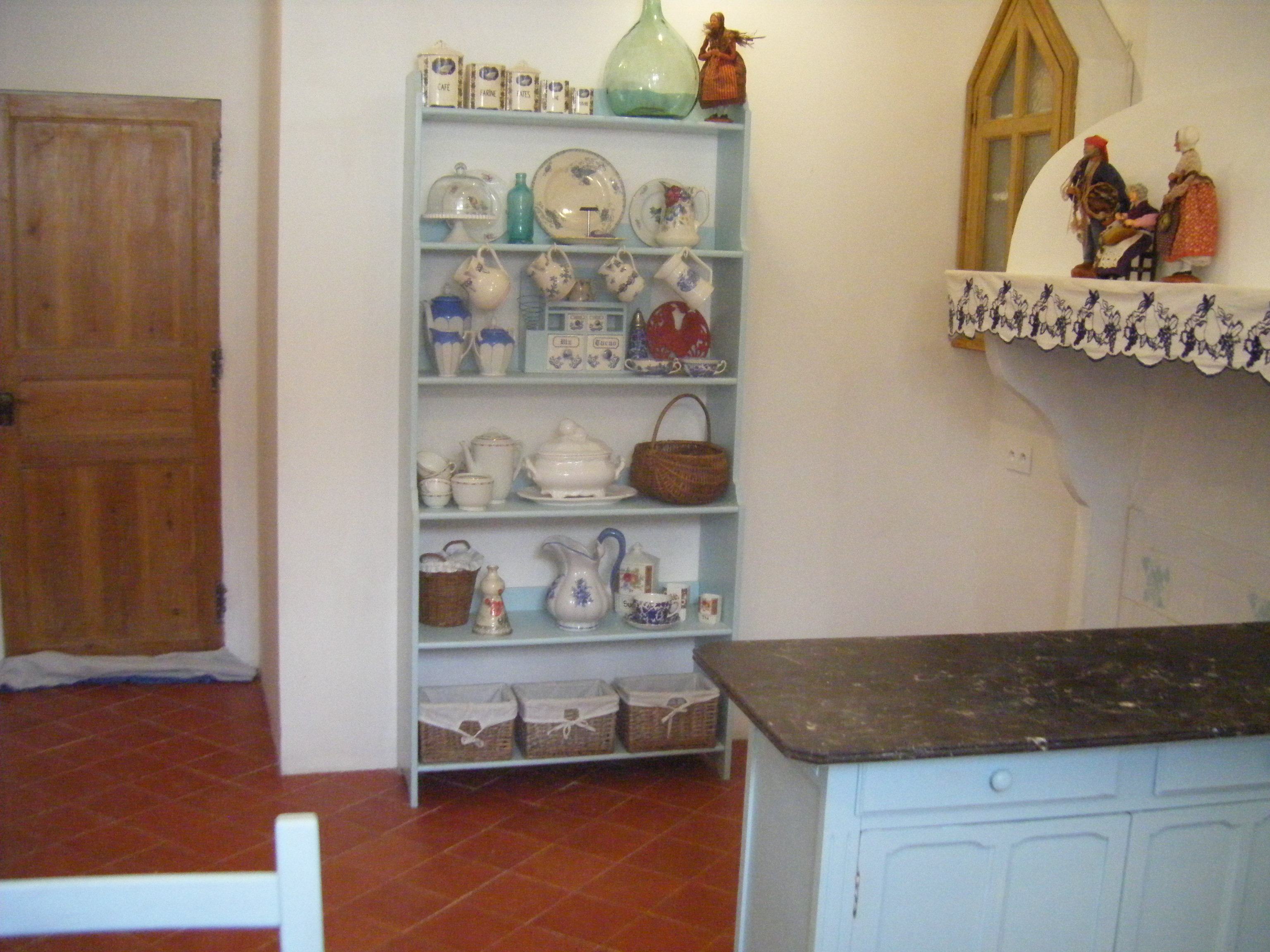 Kitchen and display of memorabilia