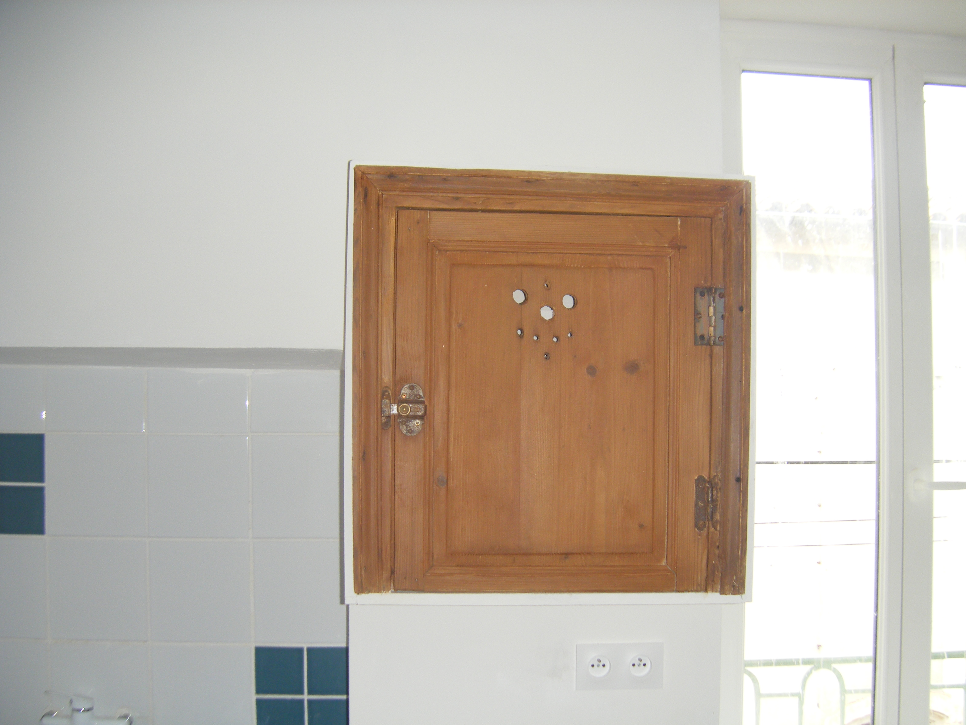Cupboard with antique door