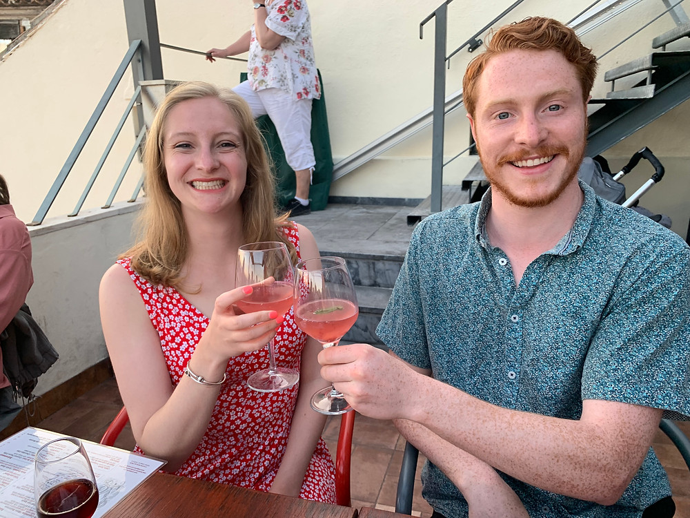 Me and my bother clinking glasses of pink sangria on the rooftop bar at Terrance BA