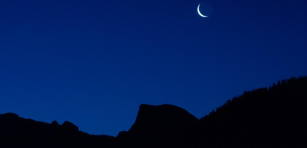 Half Dome under a sliver moon
