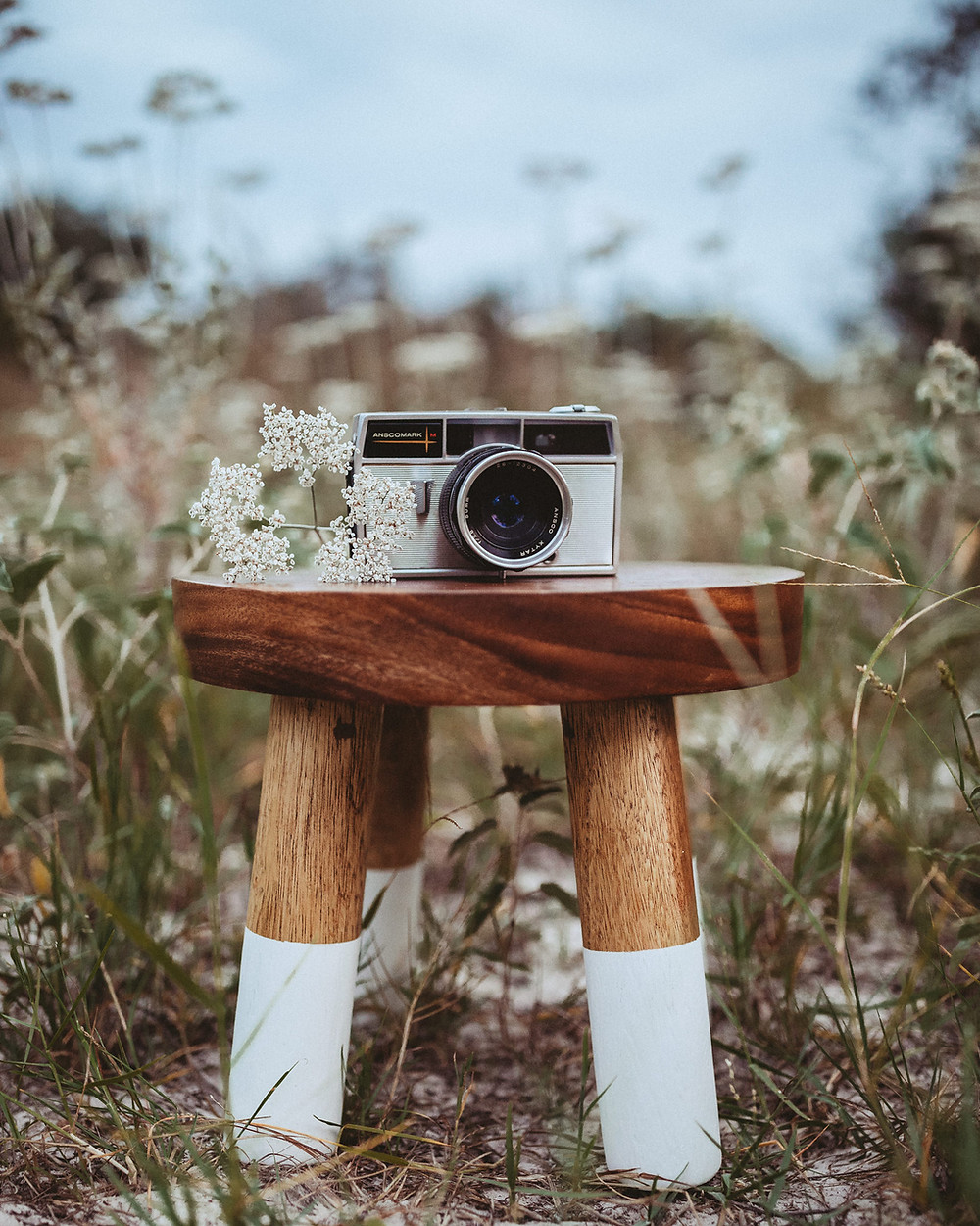 Vingtage film camera on wooden stool