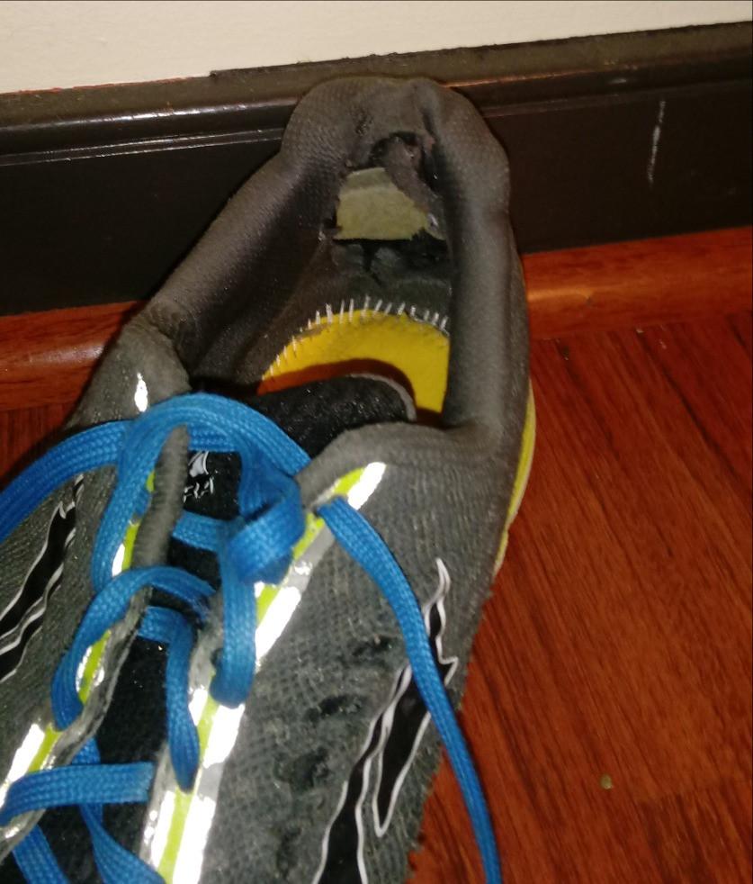 Interior of heel counter worn through by heel friction.