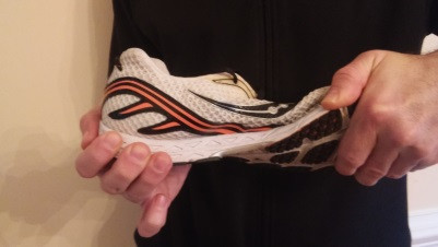 Demonstration of testing a running shoe for torsional flexibility