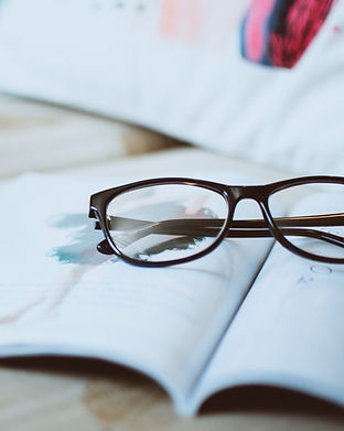 black-framed-eyeglasses-on-paper-1205292