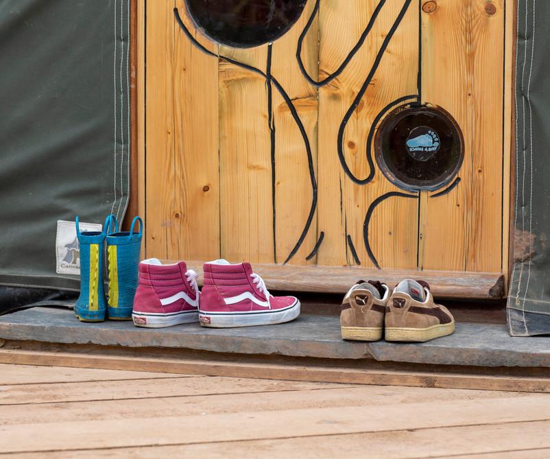 A family's shoes outside Cai Yurt