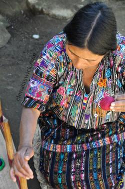 Kaqchikel weaver warping her loom