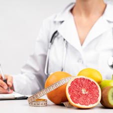 nutritionist-writing-and-healthy-fruit-s