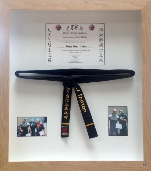 Black belt in hinged frame