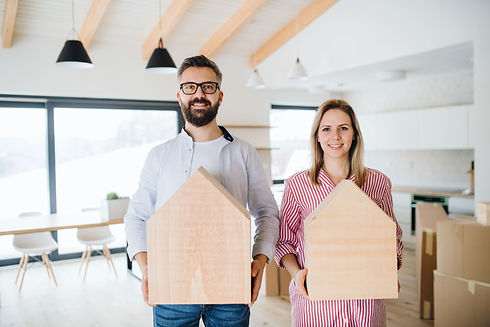 Young couple moving into their new build