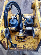 A cylinder rebuild and new hoses for an excavator quick hitch.
