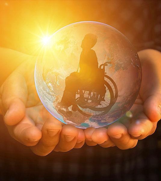 Rollstuhlfahrer Glaskugel positives denken