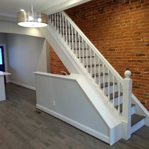 Exposed brick and staircase