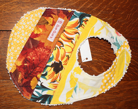 Yellow floral and leaves bib