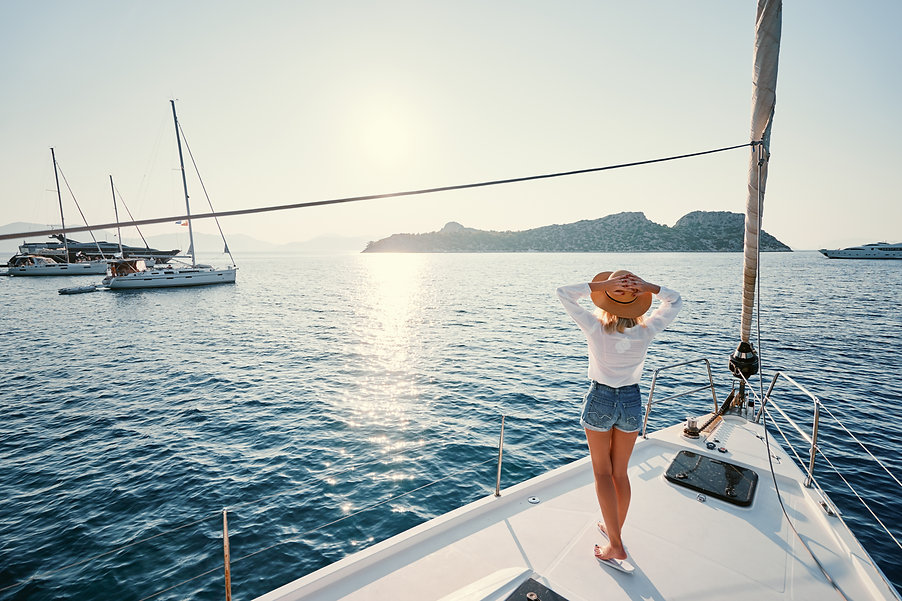 Luxury travel on the yacht. Young happy