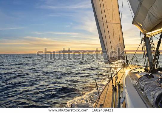 sailboat-sailing-mediterranean-sea-sunse