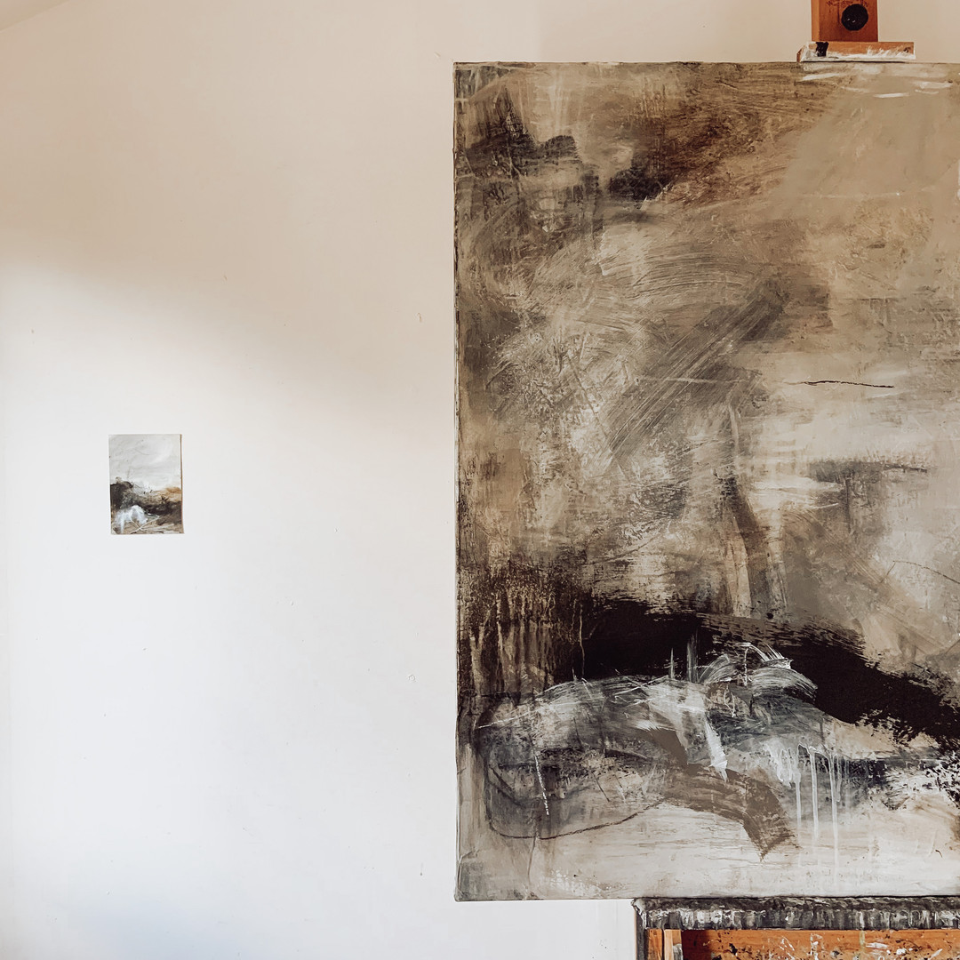 On the easel, on the wall