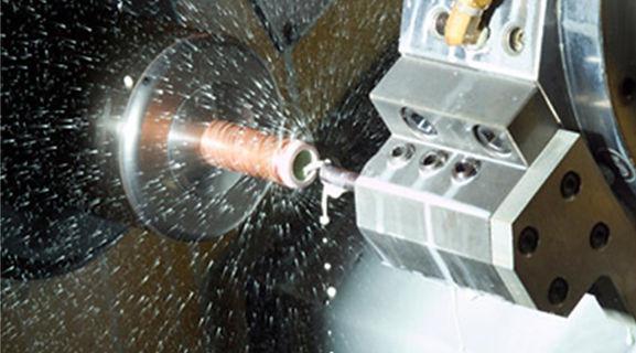 Mazak NEXUS 250 CNC lathe turning a bronze shaft with high prcision