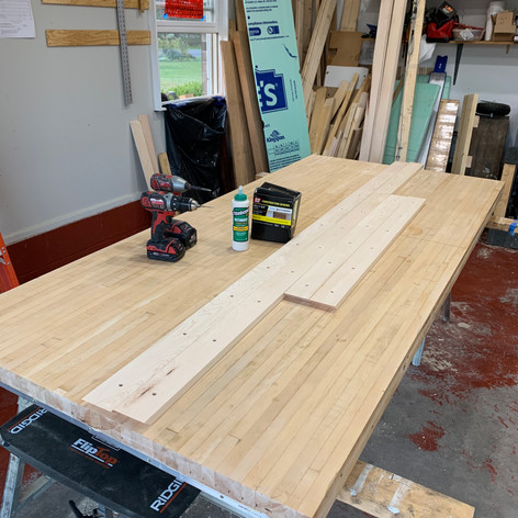 Applying Maple Trim to Bowling Alley