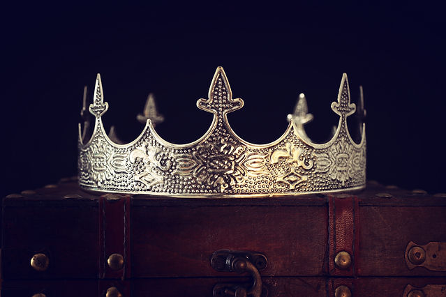 low key image of beautiful queen_king crown over wooden table. vintage filtered. fantasy m