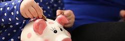 Child & piggy bank.jpg