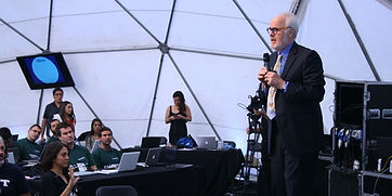 Picture of John Danner teaching in geodesic dome