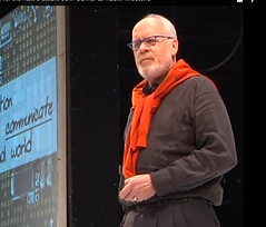 Picture of John Danner speakig about communication