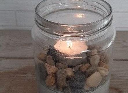 נר בצנצנת עם בטון ואבנים
