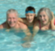 Grandparents with grandson in swimming p
