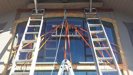 Large arched aluminum clad wood window- replaced with self dsigned glass lift