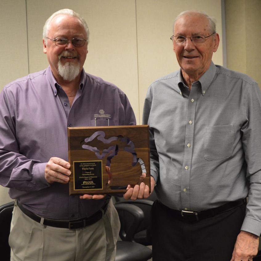 MAPA Chairman Gary Deuling (left) recognizes Wayne Foote of B & W Auto Supply.
