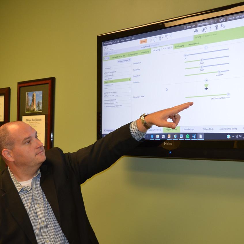 Doug Logel demonstrates hearing aid programming software.