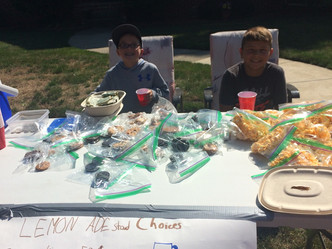 4th Grade Pair Holds Lemonade Stand to Benefit Youth Football Program