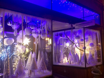 Festive Downtown Storefront Delights Onlookers