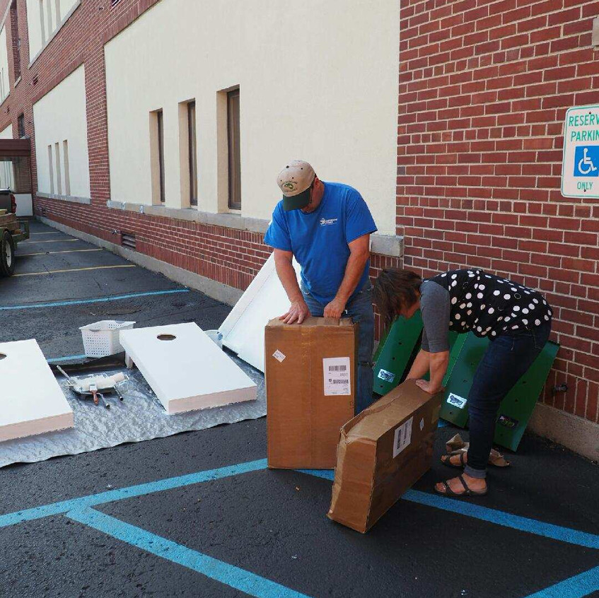 Chris Pung and Cortney Smith unpacking goodies.