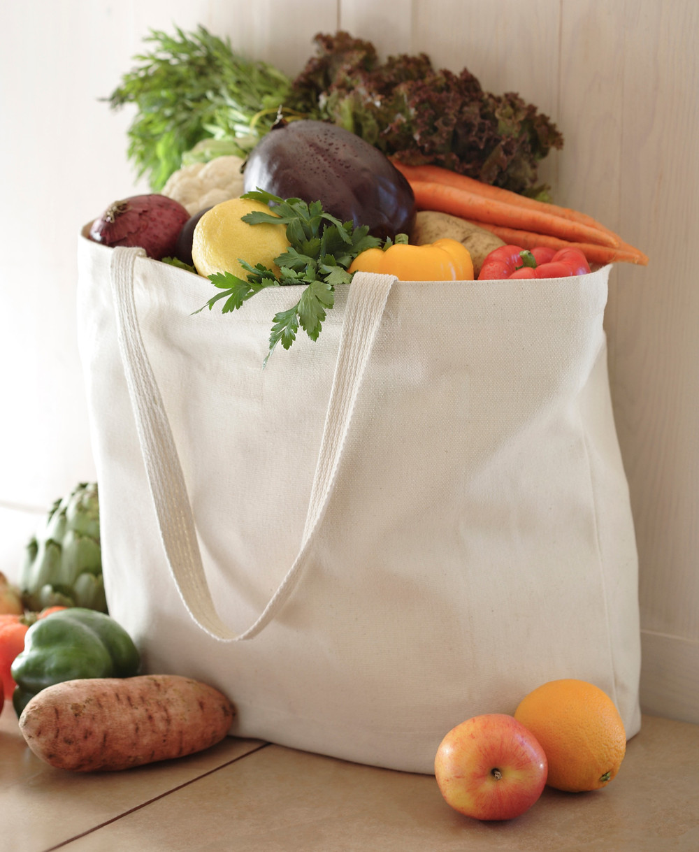 White canvas bag full of fruit and vegetables