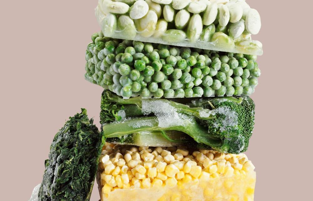 Frozen edamame, frozen peas, frozen broccoli, frozen corn, and frozen spinach stack on top of each other