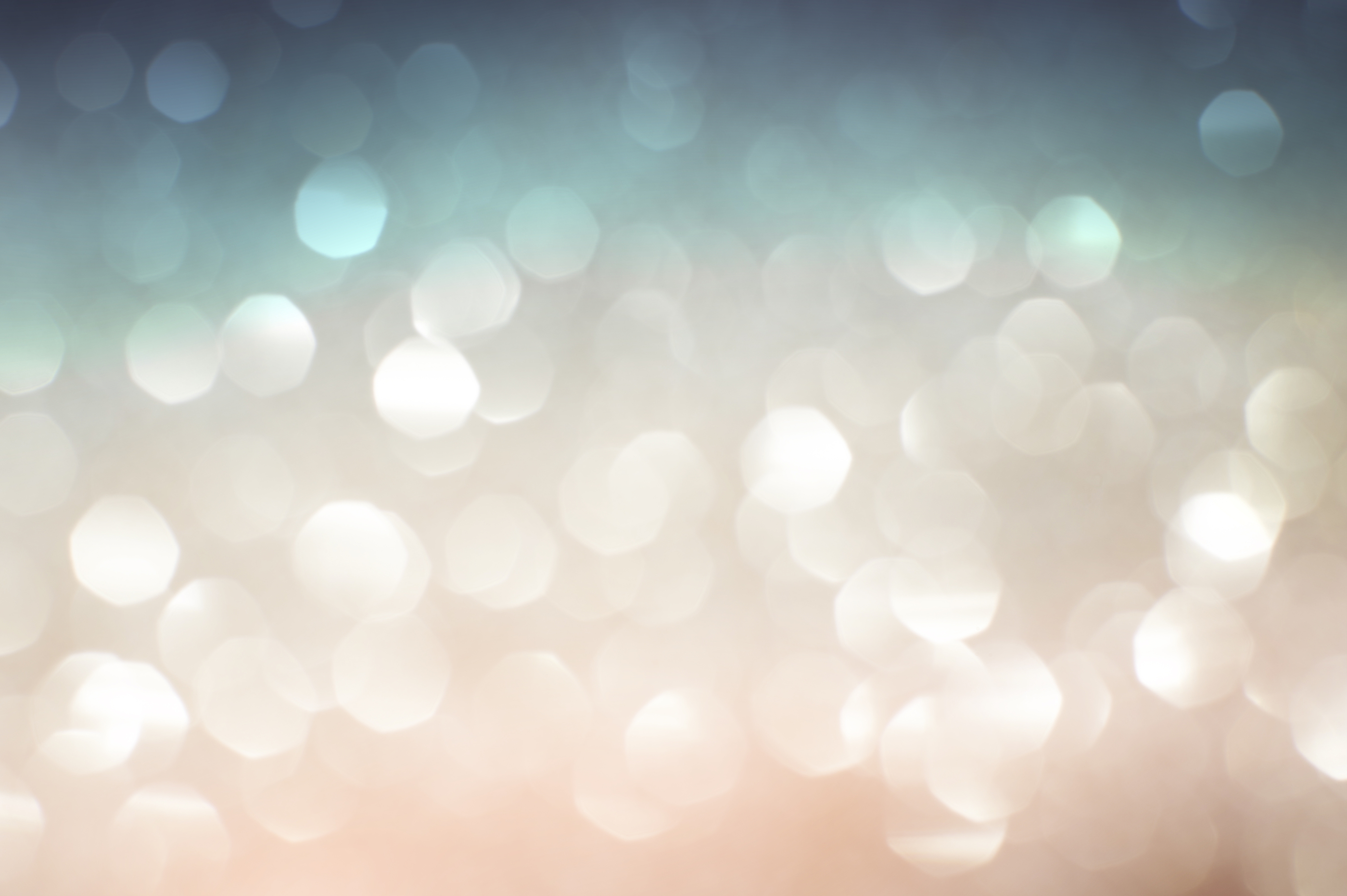 pastel colored defocused Christmas lights. Blurred abstract background