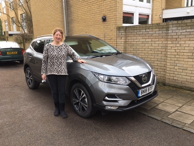 One happy customer taking delivery of their new lease vehicle