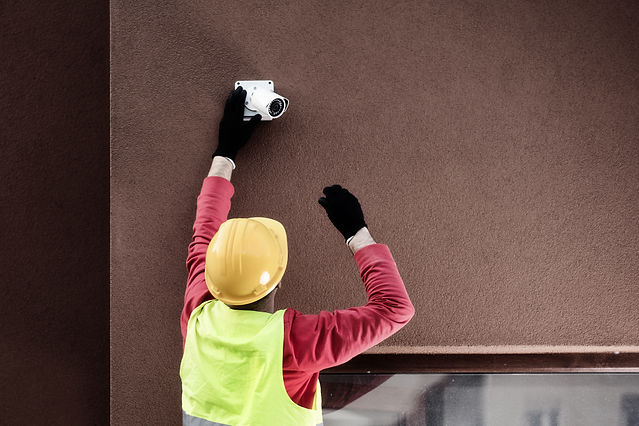 IP mini bullet camera being installed onto a wall