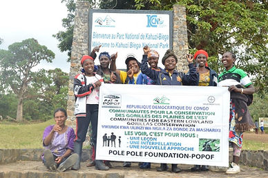 Community tourism group at entrance to KBNP