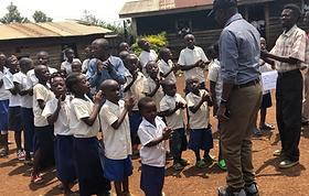 Pupils singing at POPOF primary school