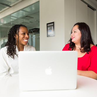 Canva - Two Women in Front of Silver Mac