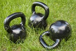 14461848-three-heavy-iron-kettlebells-in