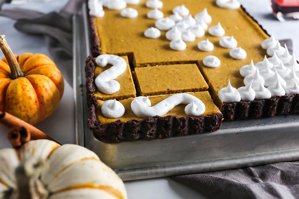 Close up image of the pumpkins and geometric slices of the pumpkin tart.